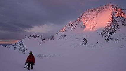 Graeme adiring the sunrise from knee deep snow
