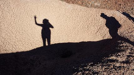 Shadows by the mud pit