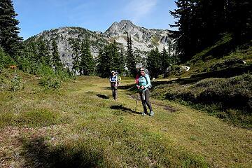 A ridgetop green crossing the ridge of Point 6438