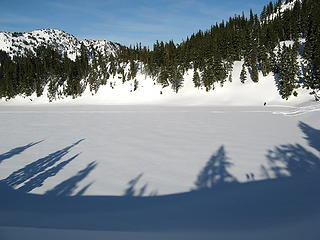 Three snowshoers on Hayes Lake - one on the far side (at upper right), two as shadows from the ridge (at lower right)