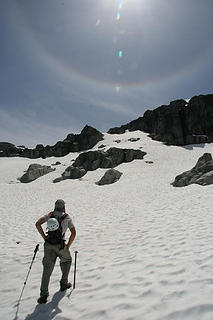 Adam looks up the snowfield towards the summit