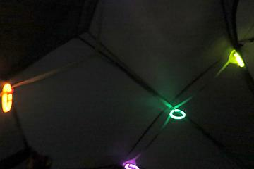 Glowing bracelets hanging inside the tent