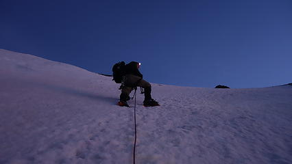Luca ascending perfect snow slopes on the SW ridge