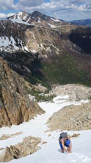 Josh descending the snow gully