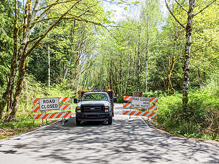 Closure at Mailbox trailhead. The King County vehicle is there to let construction vehicles through.