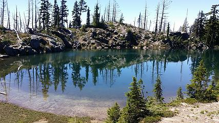 Crystal Lake at 6300' and tree line. Views of Adams, Rainier, St Helens, and Goat Rocks