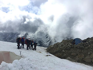 Greeting summiters - our 3-girl tent to right on dirt