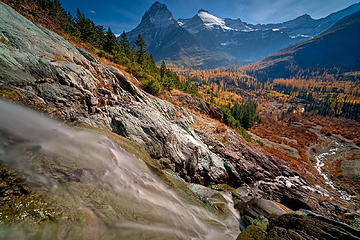 Long Knife Creek descends to join Kintla Creek on a fall day in the North Fork of Glacier National Park while the larches look on.