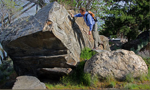 Nick Zentner inspects glacial erratic in Wenatchee - Tom Foster photo