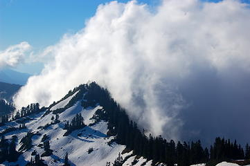 Swirling clouds at the ridgeline
