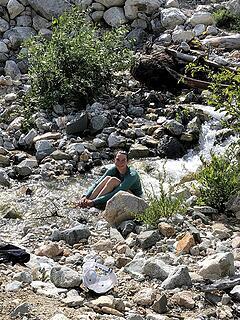 Nancy dips in the stream