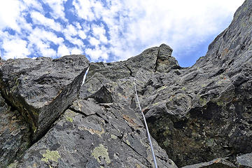 Bessemer summit block. Martin is hidden on a ledge where the rope dissapears