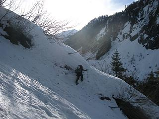 Charming icy gully crossing on the eternal traverse