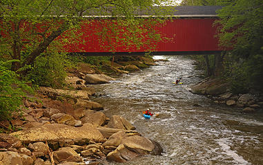 Covered bridge and kayakers