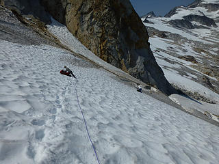 Putting on crampons for the brown sections