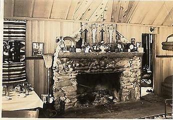 Smith Place - Queets Valley - 1930s - View of north wall of Smith addition. Note stone fireplace, Navajo rug and wall hangings. photo courtesy S. Martinson