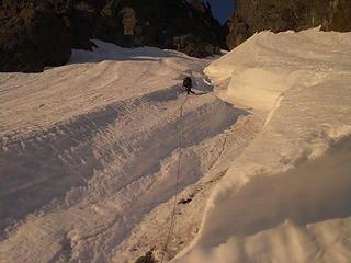 Don climbs steep snow in the snow couloir.