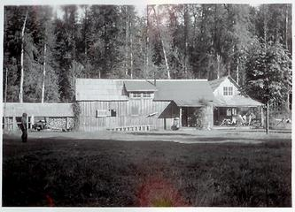 Smith Place - Queets Valley - ca. 1929 - view looking east - L to R woodshed, bunkhouse, original Shaube structure, Smith addition - photo courtesy L. Vaughan