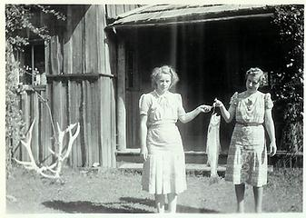 Smith Place - Queets Valley - ca. 1929 - two women holding fish in front of porch - photo courtesy L. Vaughan