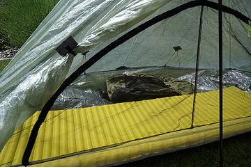 View through bug netting with thermarest and arcblast pack side by side.