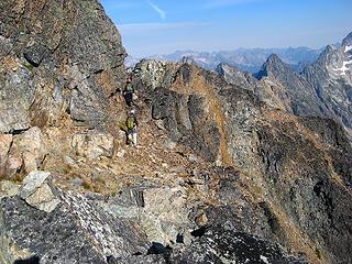 Returning on the circum-summit ledge.