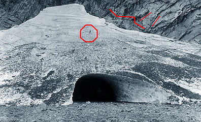 Big Four Ice Cave in (fall) 1920. ...... Man standing on glacier (circled) for scale.