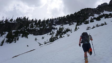 Headed for 6200 foot bench on east ridge (visible at center left)