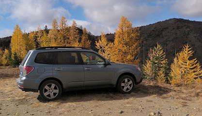 My car at the Pyramid Mtn trailhead, with Crow Hill shaded in the background.