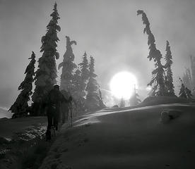 Snowshoers approach Maple Pass through mist in North Cascades National Park.