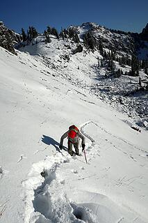 Kicking steps upward to the ridge crest