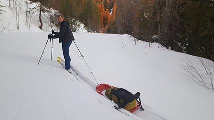 Pulling sleds up the road is much easier than carrying a heavy pack