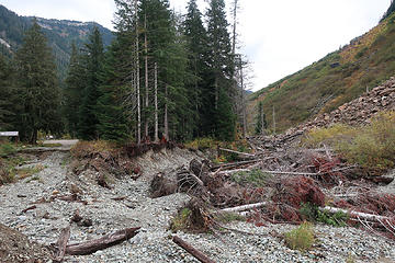 not easy to repair. The diverting rockfall is visible on right, former road end on left.