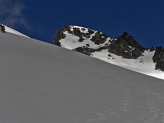 Adam and Heather snowshoe towards the ridge