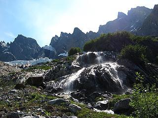 Water, brush, glaciers & peaks looming above us