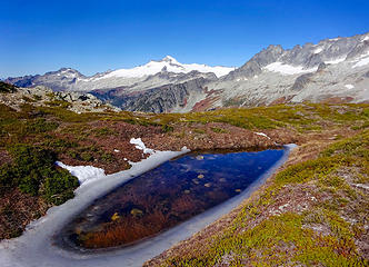 Snowmelt tarn on Sahale Arm & Eldorado Peak
