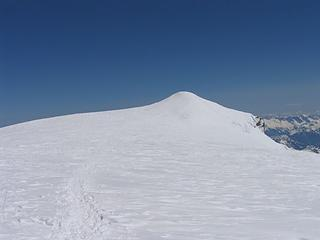 Looking across the summit plateau at the true summit
