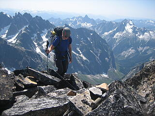 Jake reaching the remote summit of West Fury in the Picket range