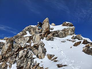 Downclimbing the summit block. Snowy class 3 in crampons.