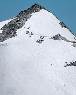 Climbers on Vesper's summit block