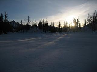 sun coming up at the upper lake