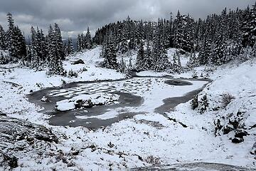 My favorite Rampart tarn with its island and snow patterns