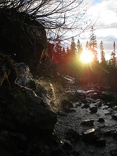 low angle sunlight on waterfall over pct