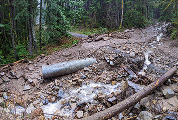 At upper right the mud flow cut through a small ridge crossed the road. This is the part of the mud flow that is the first encountered below on the CCC trail section.  Map: location 3