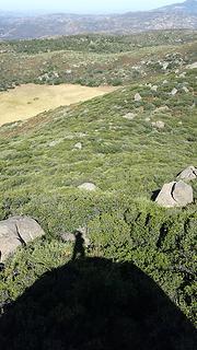My shadow atop summit rock