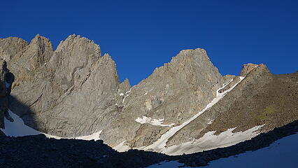 The east ramp is the obvious rightward ascending line between the black scree and the thin couloir; Woosley just to the right