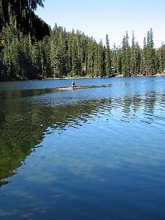 Fisherman on a log raft on Slide Lake