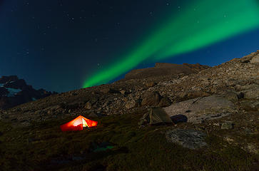 Despite full-moon brightness that limited the number of visible stars, the Aurora Borealis blazed through the sky above our mountain campsite high above Torssukatak Sound in southern Greenland.