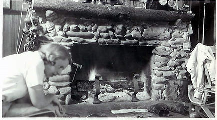 Smith Place - Queets Valley - Marion V. Wood in front of fireplace on north wall of Smith addition - photo courtesy L. Vaughan