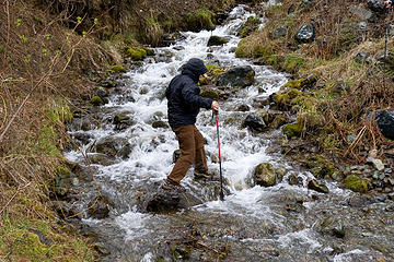 Hikers try to keep there feet dry while crossing McCrea Creek, West Fork Rapid River Trail, Idaho.