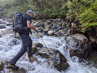 The Pratt River was channeled into some gaps between big rocks here. The rocks were wet and a little slippery but we made it work. We found an easier crossing more upstream on the way out.